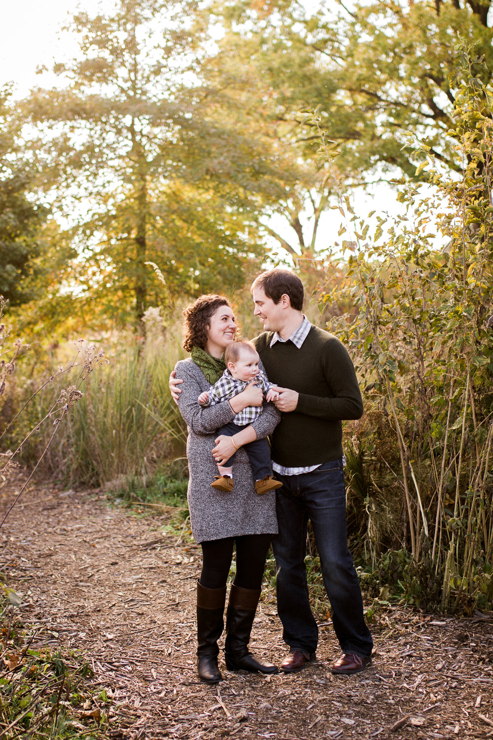 Family photo in the autum fields, Kansas City fall family photos, candid family portrait