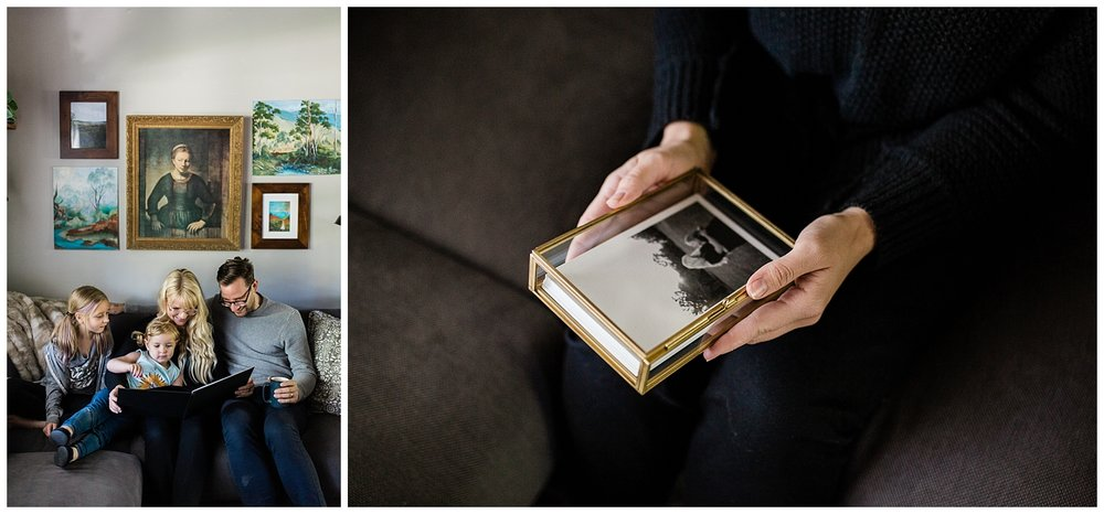 Family relaxes on the couch while looking through a photo album, Kansas City family photographer offering heirloom photo print products, in-home family photos