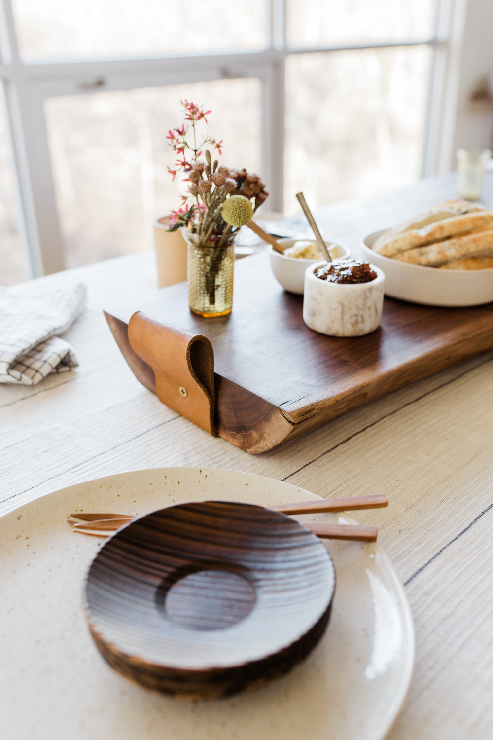 Thick cutting board with leather handle and a vase of flowers, Halo youth cutting board styled session, Kansas City lifestyle product photography, Rebecca Clair Photography