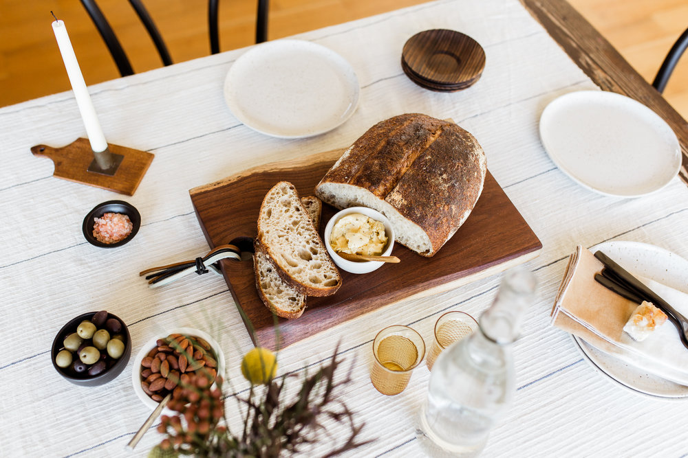 Overhead photo of rustic bread board with butter, Halo youth cutting board styled session, Kansas City product photography, Rebecca Clair Photography
