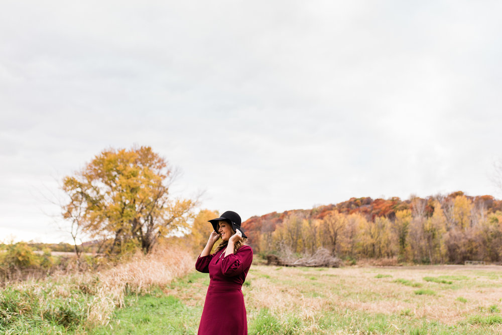 Woman wearing a hat in an autum field, Parkville portrait session, Kansas City natural branding images, Rebecca Clair Photography