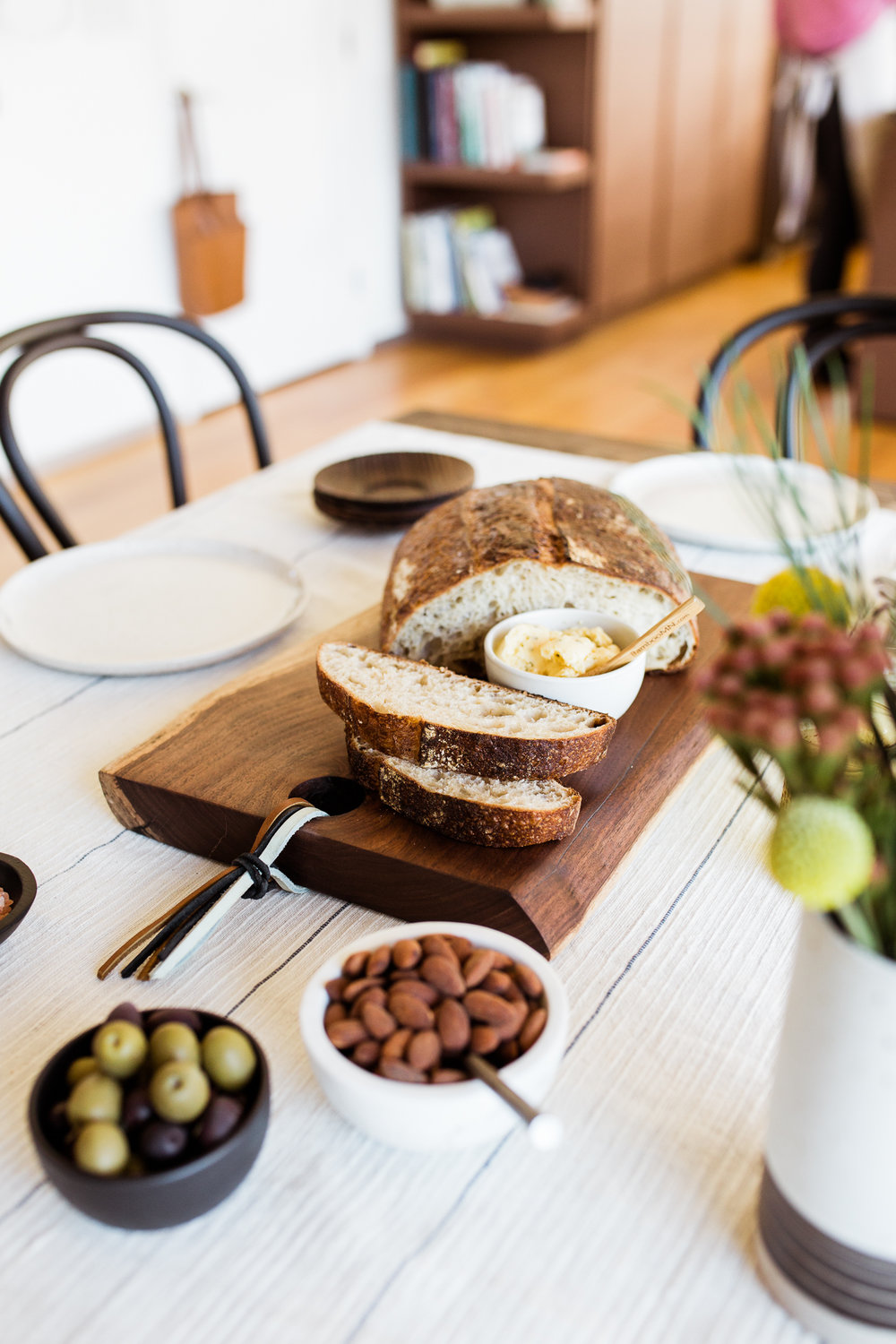 Photo of rustic bread board with butter on a styled table, Halo youth cutting board styled session, Kansas City food photographer, Rebecca Clair Photography