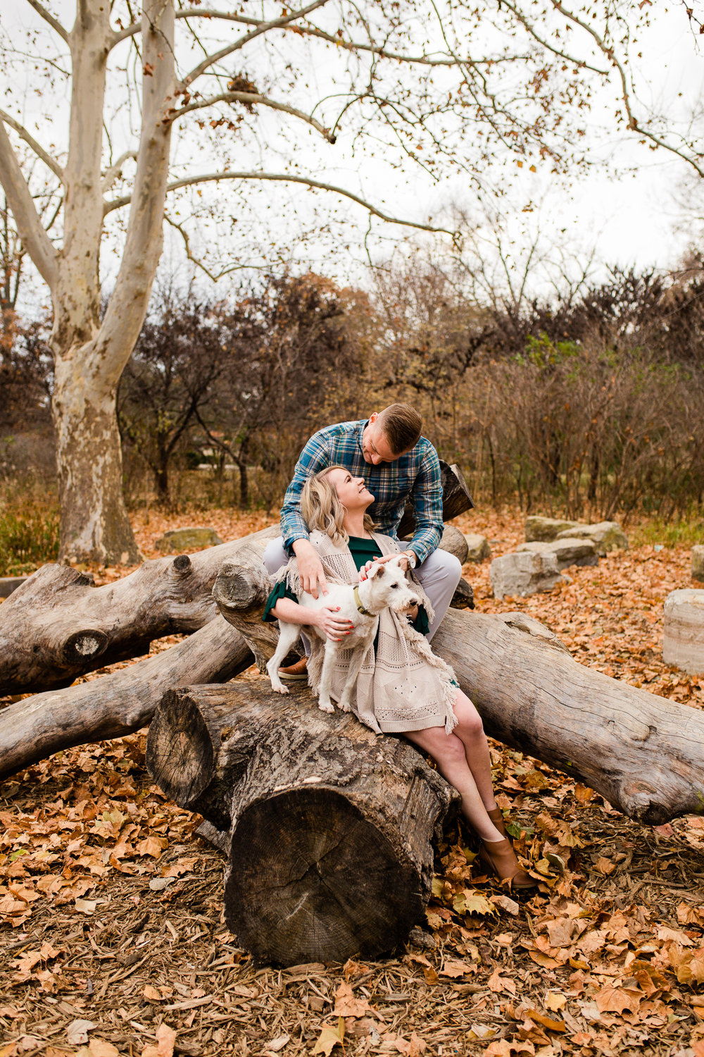 A couple sits on longs with their dog, Kansas City engagement or anniversary session, Rebecca Clair Photography