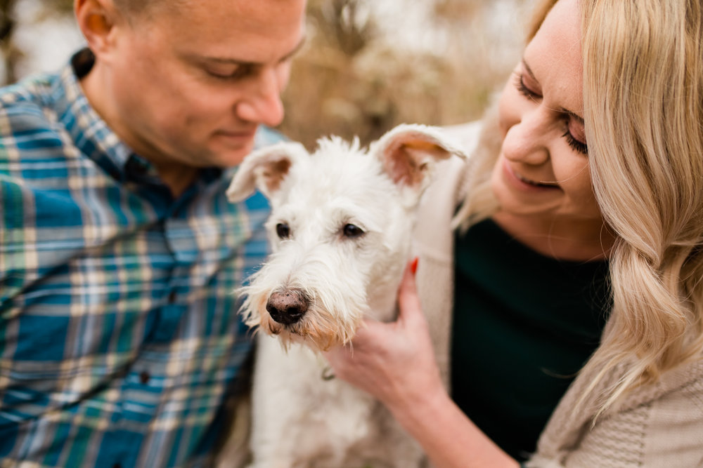 Couple holds their dog together, Kansas City couples photographer, engagment photos with your dog, Rebecca Clair Photography