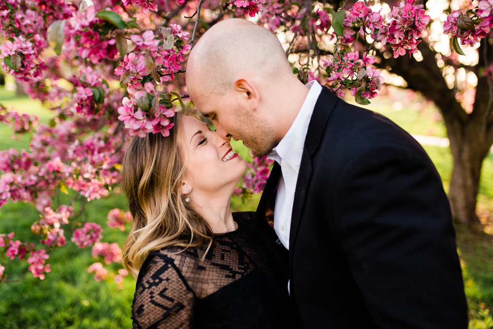 Couple rubs noses in the spring evening light, Kansas City spring engement session, Rebecca Clair Photography
