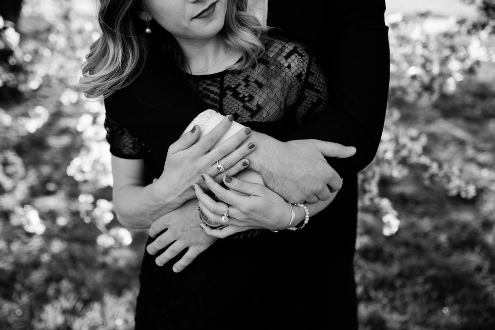 Black and white detail photo of couple embracing, hands together, Kansas City artistic engagement photos, Rebecca Clair Photography