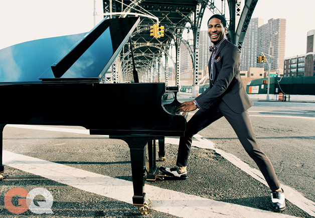 Jon Batiste serenades the early-morning commuters, tucked under the West Side Highway in Harlem, NYC