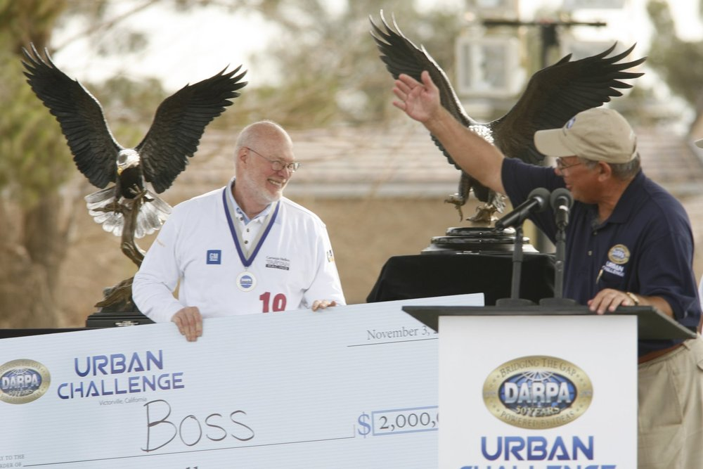 Red receiving the $2,000,000, 1st place prize in the 2007 DARPA Urban Challenge.