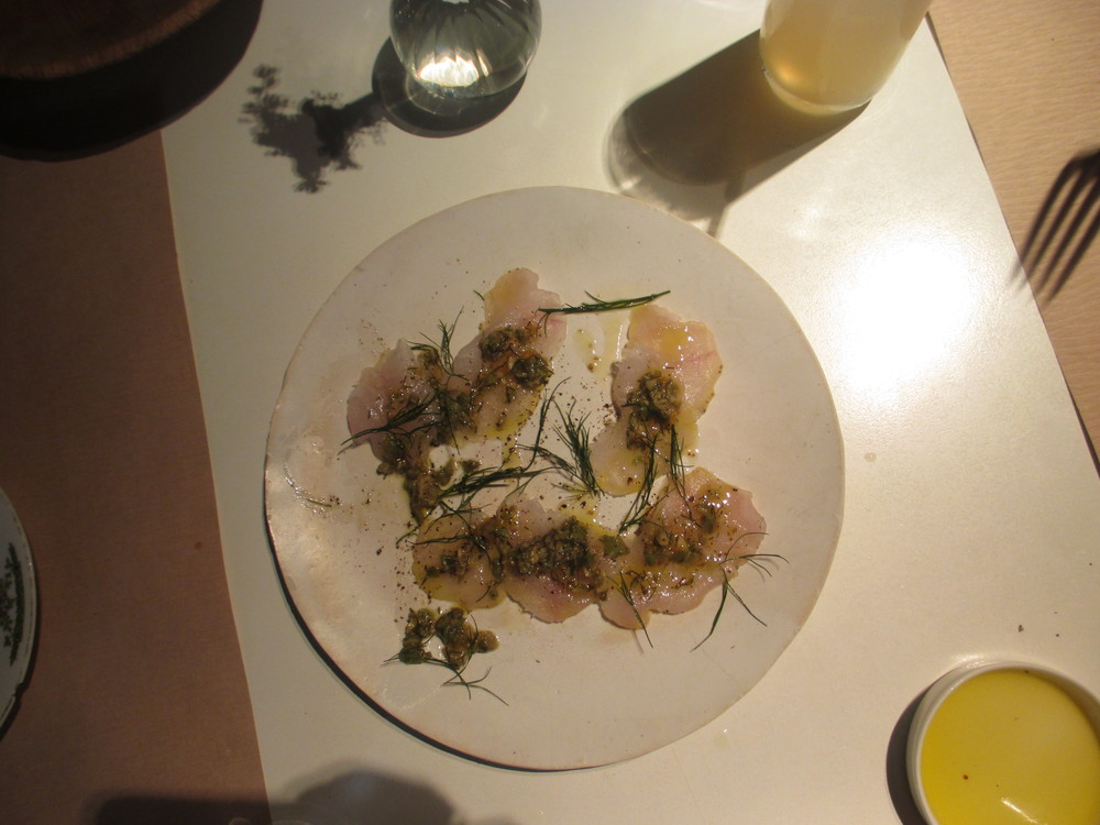 Shaved raw fluke, crushed olives, dill, lemon, and chilies
