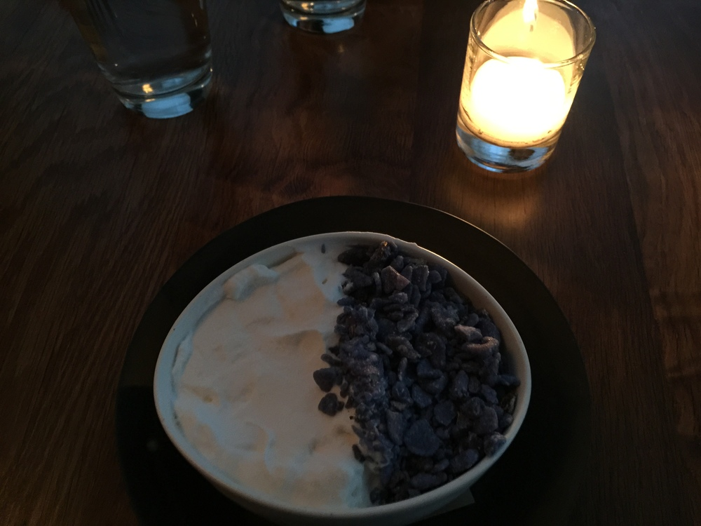 Chocolate pudding with lightly whipped cream and crystallized violets