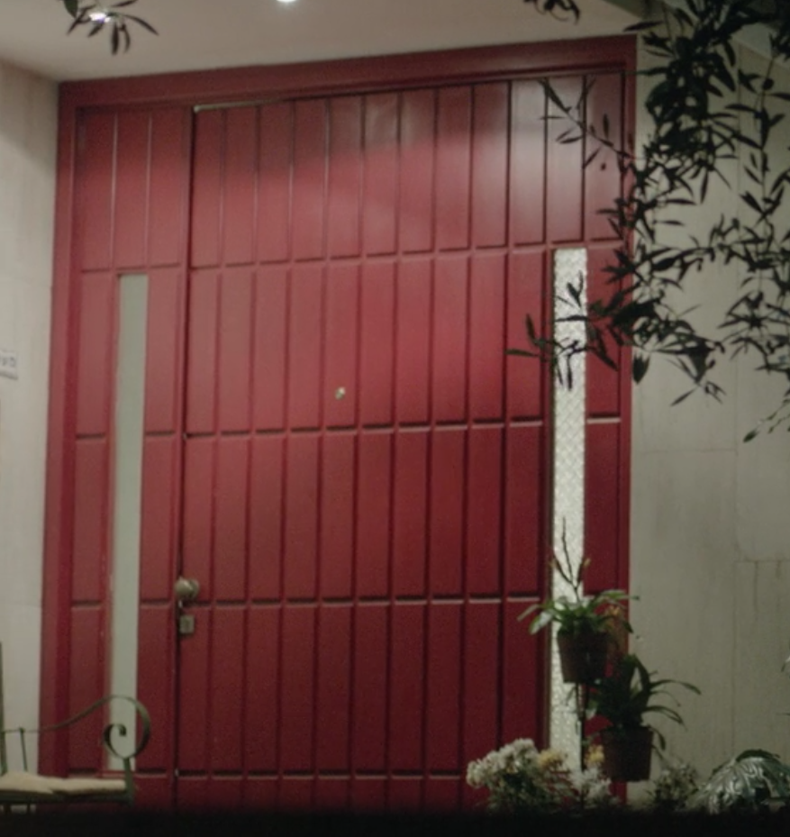 "Quite massive residential entrance door. Effect of size enhanced by raised panels used on both doors and sidelights. Image borrowed from the movie ""Hostages""."