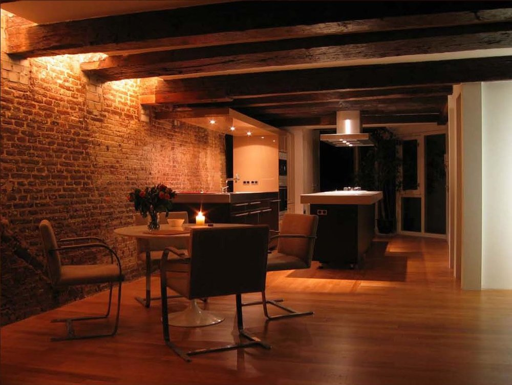Exposed brick wall in a loft apartment. Illuminated from above to enhance its texture.