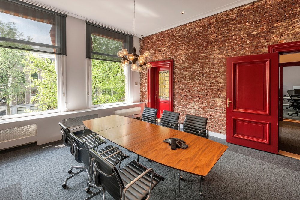 Exposed brick wall in small conference room of advertising company  AKQA  in Amsterdam.