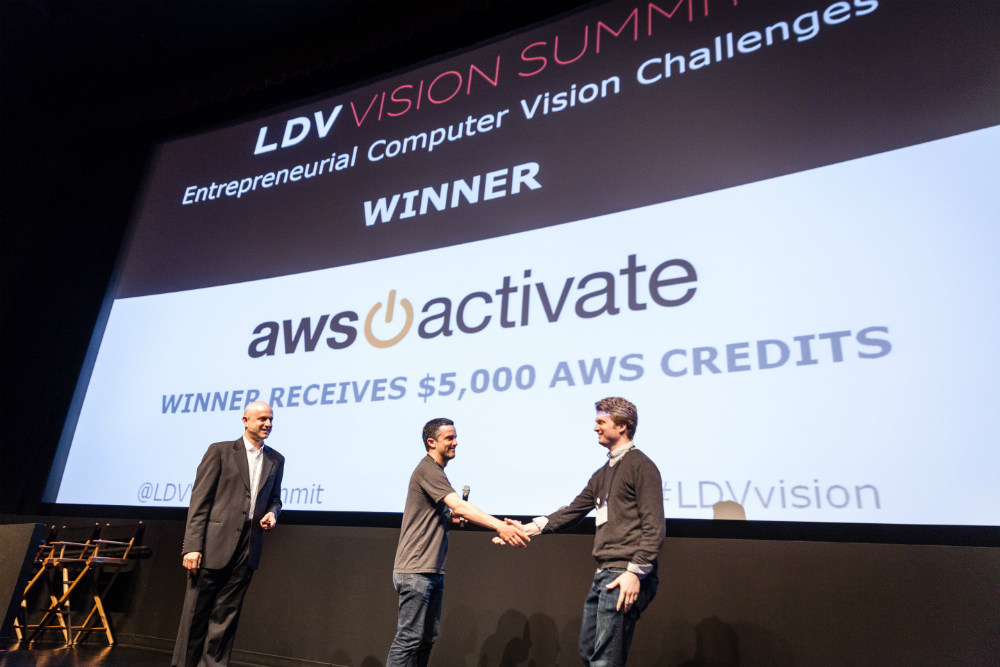 LDV Vision Summit 2016, Entrepreneurial Computer Vision Challenge Winner: Grokstyle, co-founded by Cornell researchers Sean Bell and Kavita Bala. Serge congratulating CEO Sean Bell. ©Robert Wright