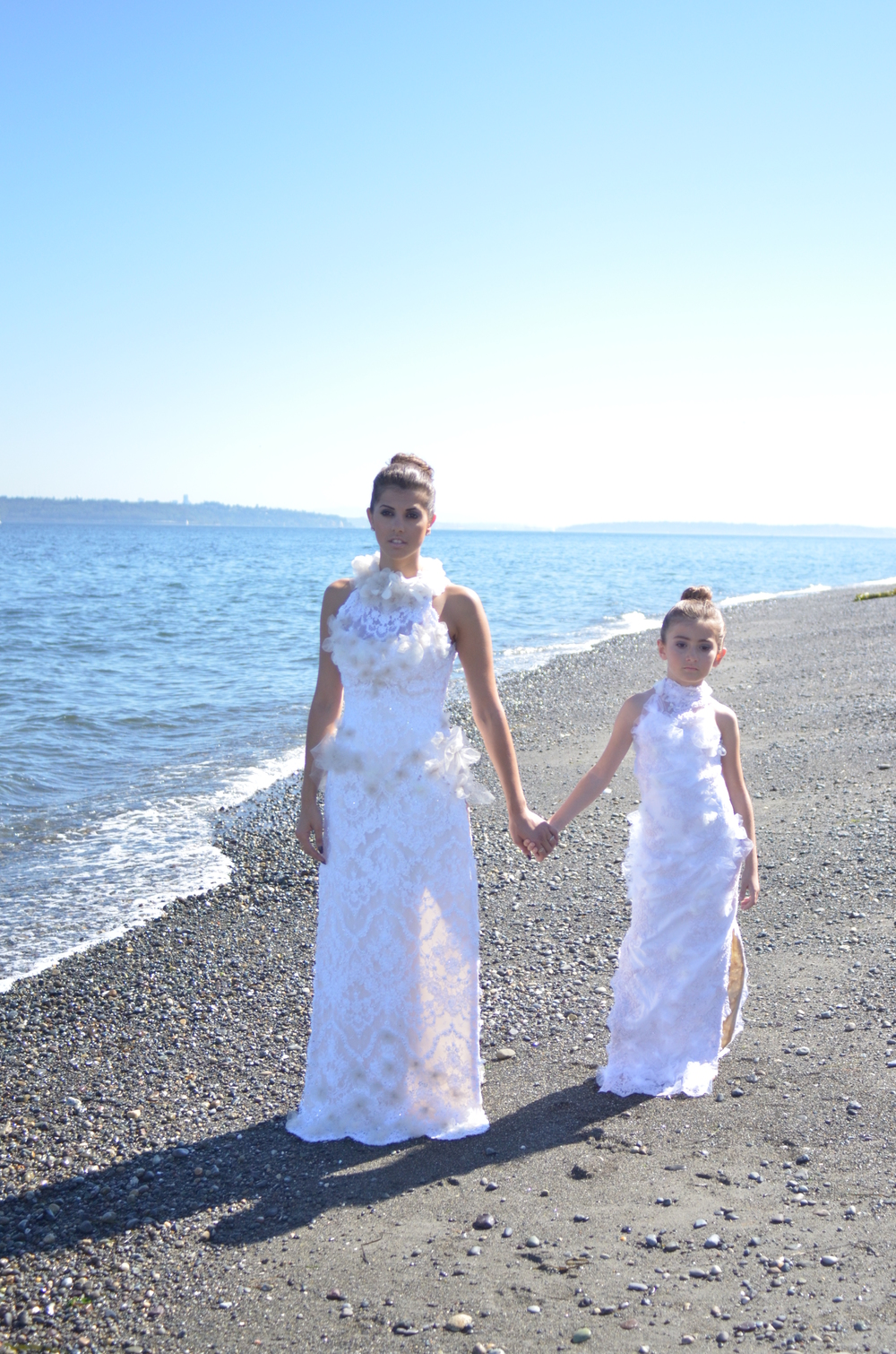 "Ms. Lina Zeineddine and Ms. Victoria in ""Handing Down The Bridal Tradition"" on the beach at Fay Bainbridge Park, Bainbridge Island WA."