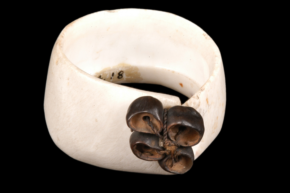 PAPUA NEW GUINEA  Mwali armband made from vegetal fibres, seeds and conus mille- punctus shell. Massim Region.Beginning 20th century