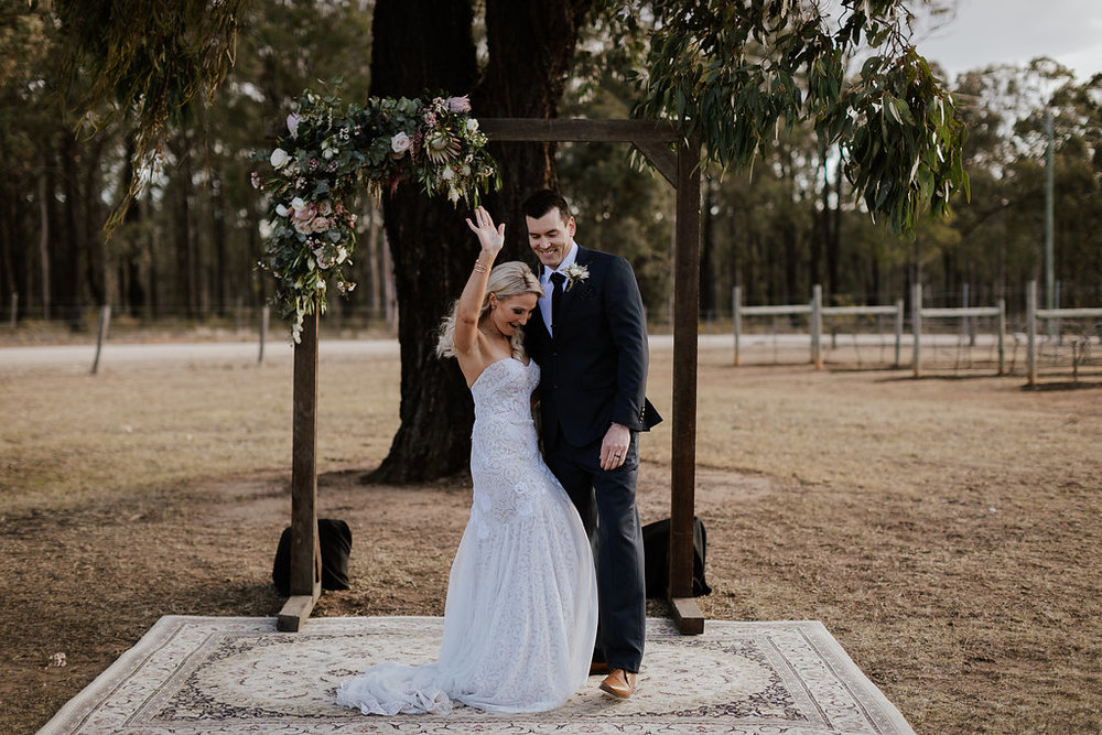 Lauren and Michael letting loose after being married at Ironbark Hill Vineyard, Hunter Valley