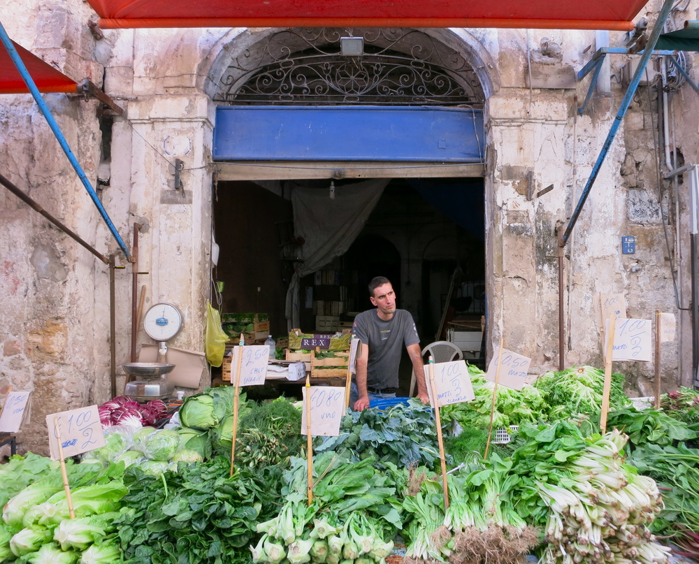 I loved the market stalls tucked into arches and doorways and pockets of various alleys. You could easily lose yourself for hours in the market. © 2014 Gail Jessen