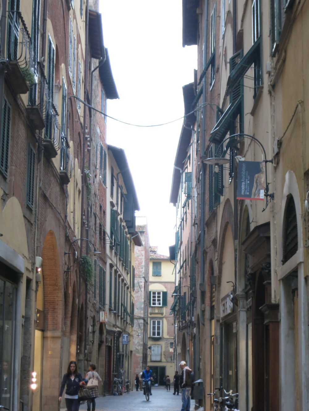 "Streets were intentionally built narrow and tall to confuse ""visitors"" who would like to invade Lucca and make it their own. © 2014 Gail Jessen"