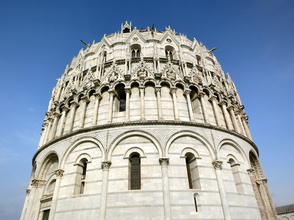 The Baptistery in Pisa houses a pulpit carved by Pisano, considered the first work of Renaissance art. © 2014 Gail Jessen