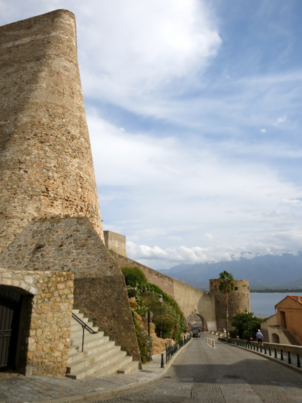 The walls of the Calvi citadel impose their presence over the tiny town. © 2014 Gail Jessen