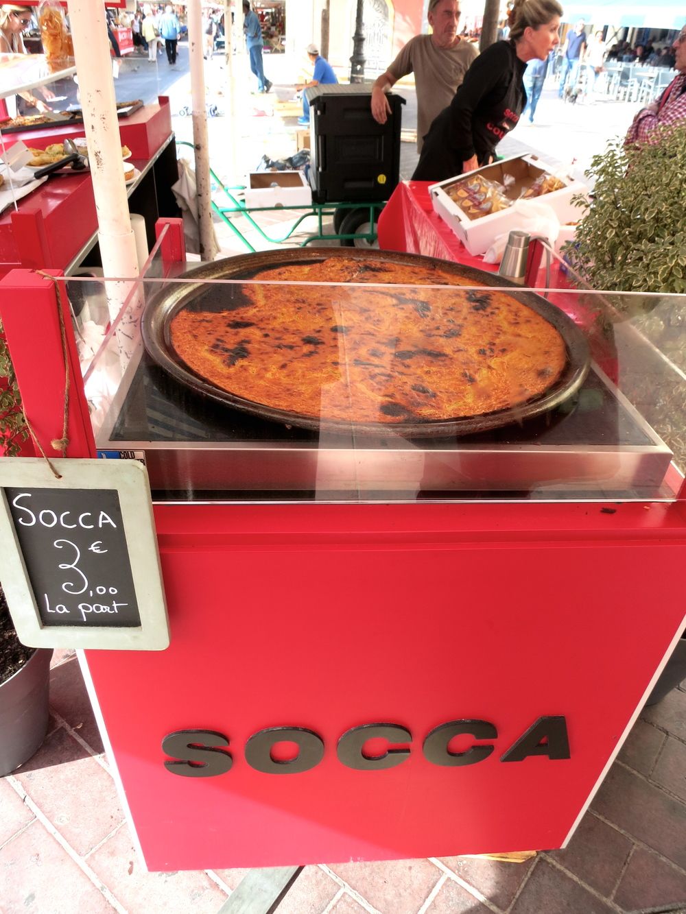A gluten-free street food snack?! All over it. The Socca was delicious and a huge portion for 3 Euro. © 2014 Gail Jessen