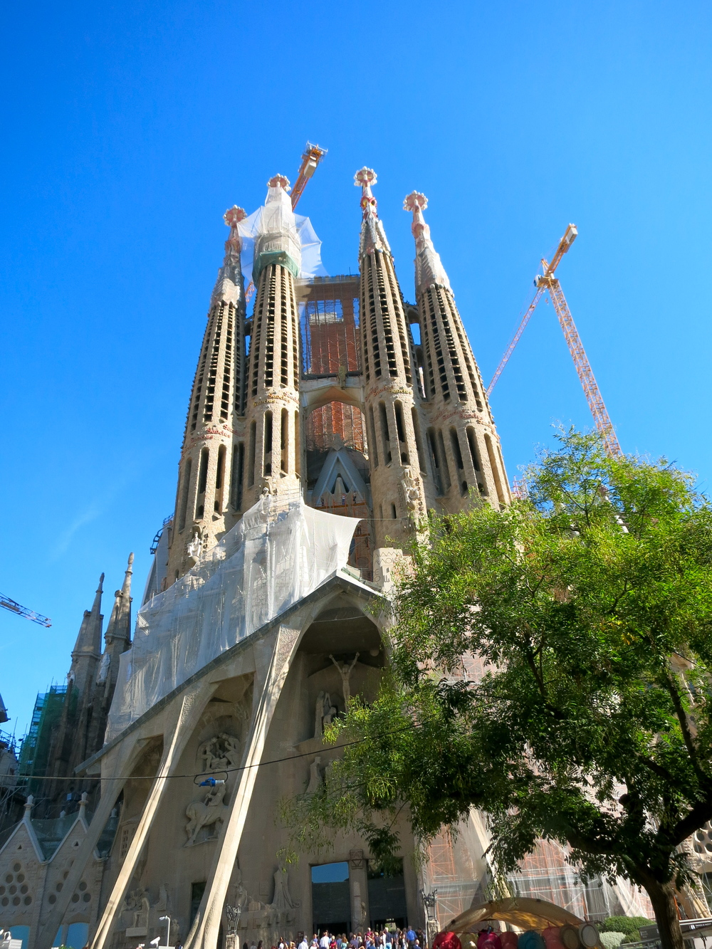 When Gaudi died in 1926 only one tower was complete. Today there are eight towers, four at each entrance to La Sagrada Familia. © 2014 Gail Jessen