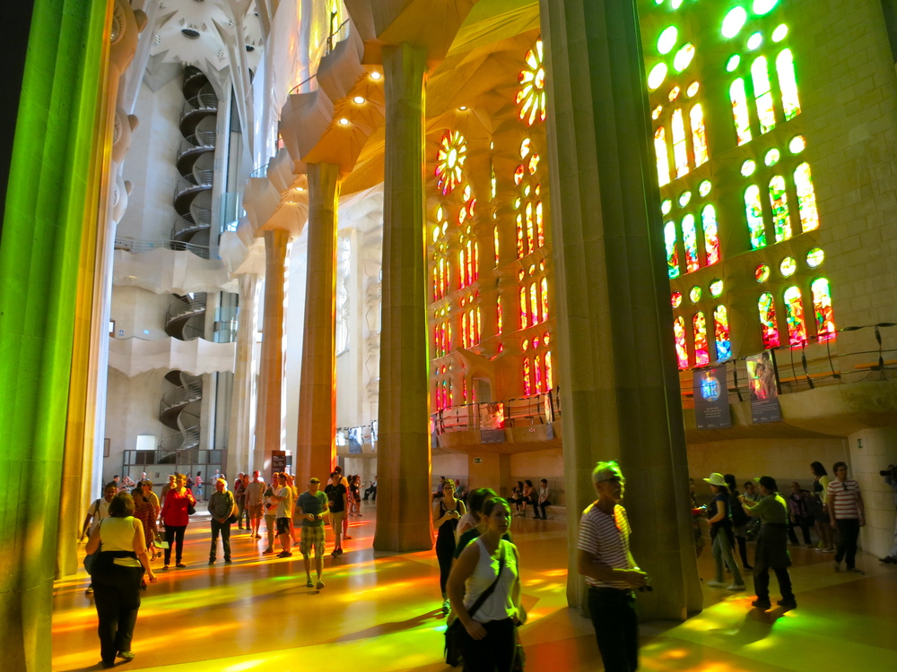 The stained glass windows face perfectly west and east, flooding the cathedral with colorful light all day long. Even in the two hours I was inside I watched the light change dramatically, a tribute to one of Gaudi's primary inspirations. © 2014 Gail Jessen