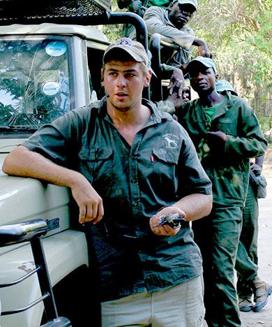 South African native Craig Windt and Mozambican members of the antipoaching squad he leads get ready to start their daily patrol. (Photo: Laura Krantz)
