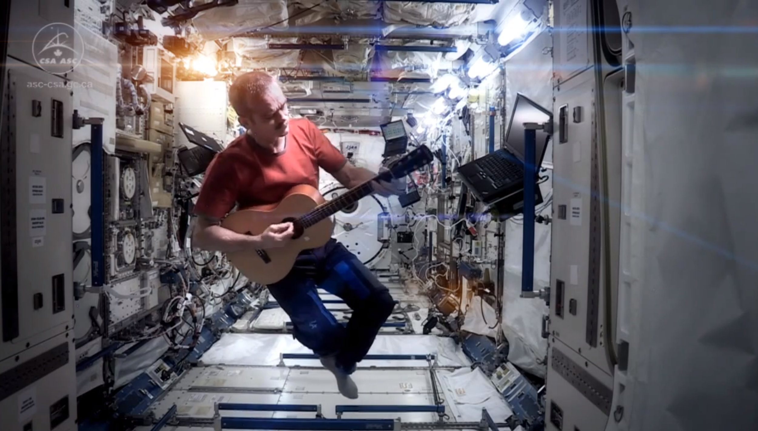 Commander Chris Hadfield perfroming Space Oddity aboard the ISS
