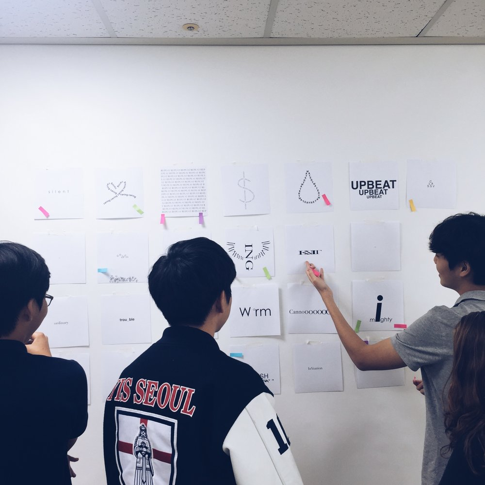 Visual Design students participate in a critique on designing with type.