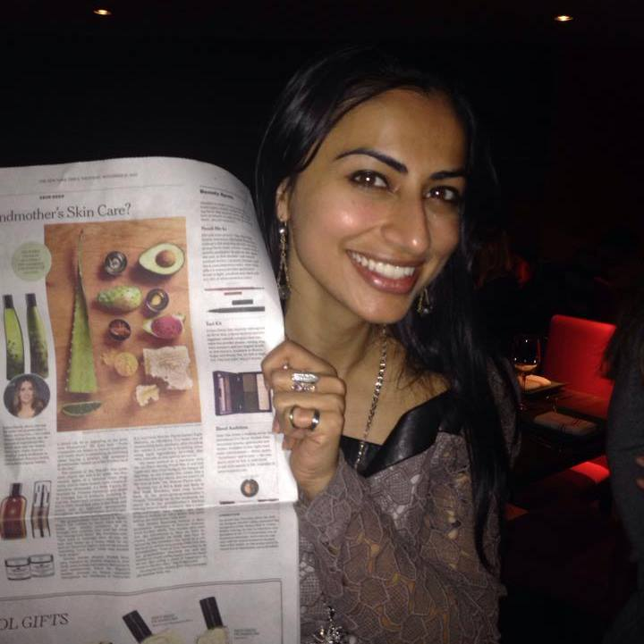 Founder Shaffali M. displaying the NY Times article highlighted Shaffali Beauty + Wellness as a s kincare line based on family recipes - which is certainly us!