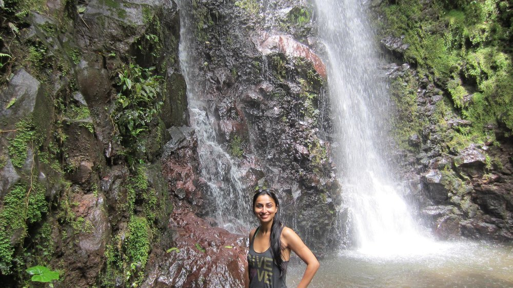 Me Posing with one of the MANY waterfalls in Costa Rica