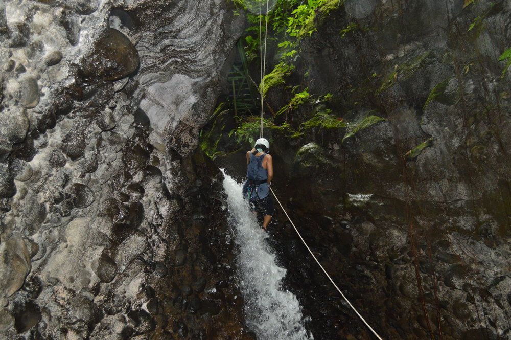 "L: Waterfall Rapelling for the first time! Its like Rock Climbing but you are going down and ""walking with the waterfall""!"