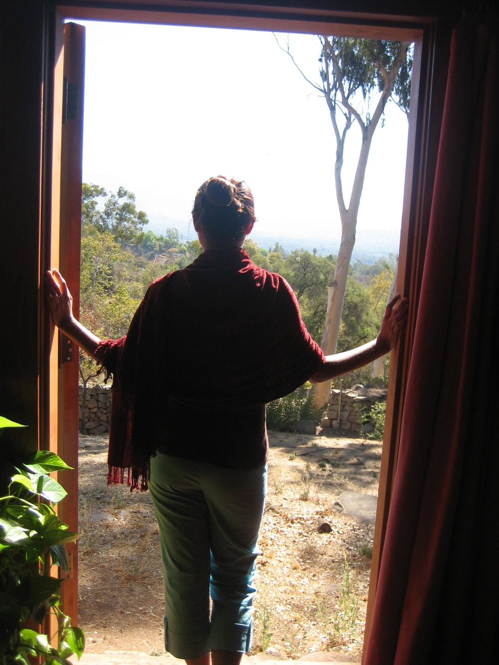Dream Sanctuary for the Soul Dance Retreat: Eva receiving Tibet bowl vibrations – Me looking out at the beauty of our sacred place