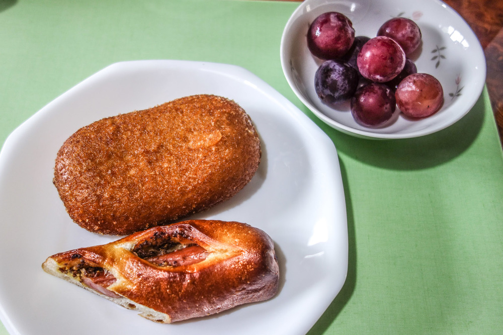 CURRY PAN (CURRY FILLED BREAD COATED IN BREAD CRUMBS).   HOT DOG FILLED JAPANESE BREAD.