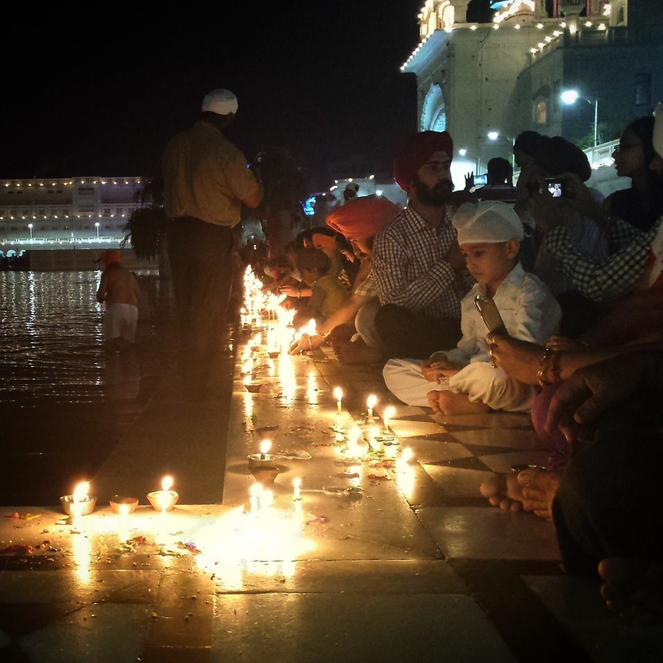 Candle lights at the Golden Temple-photo by Punam.jpg