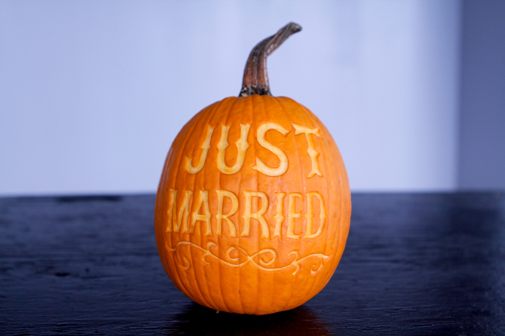 """Just Married"" sugar pumpkin for wedding photos."