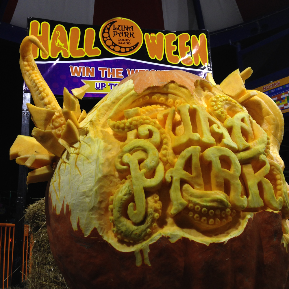 A 1000 pound giant pumpkin at Luna Park, Coney Island carved by Marc, Lenny, and Adan.