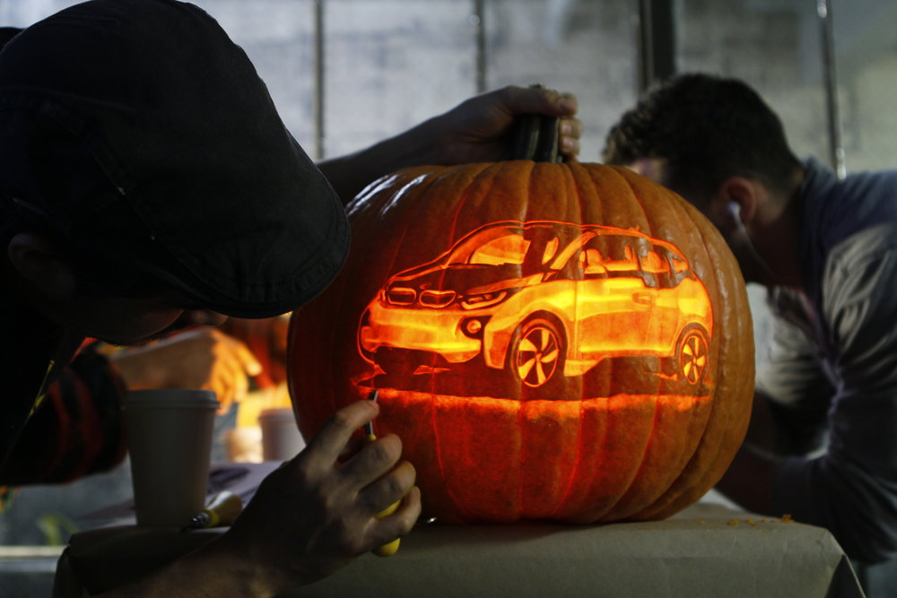 Chris Soria fine tuning a ride for BMW USA.                          Join our incredible list of clients and partners   Our pumpkin carvings make stunning images and captivating time-lapse videos. We make your advertisements shine. A great way to engage your audience or fan base in a fun and creative way. Our pumpkins frequently go viral on the web, appealing to people of all ages around the globe.