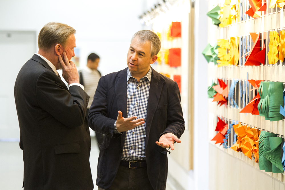 The Dean of the School of Architecture and Planning, Robert Shibley, FAIA, talks to Prof. Miguel Guitart at the exhibition Mapping Emotional Perceptions: Laboratory of Paper. May, 2016. Photograph by Mahan Mehrvarz for B/a+p.
