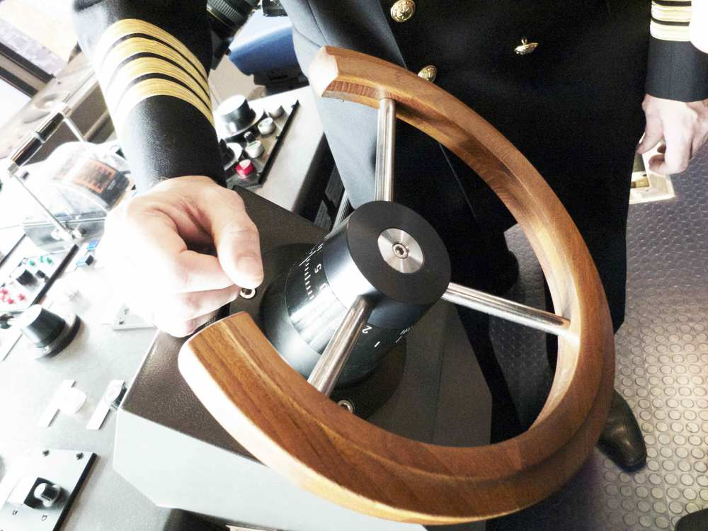 Modern super ships still have wooden steering wheels. This picture is from a MAERSK triple E class container ship.