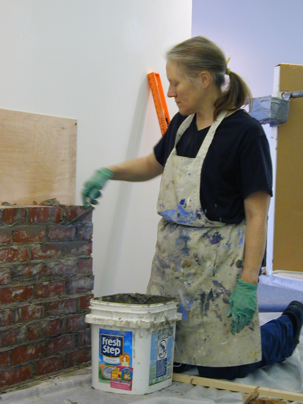 Maggie laying bricks for Memorial Wall to Colby Women, November 2006.