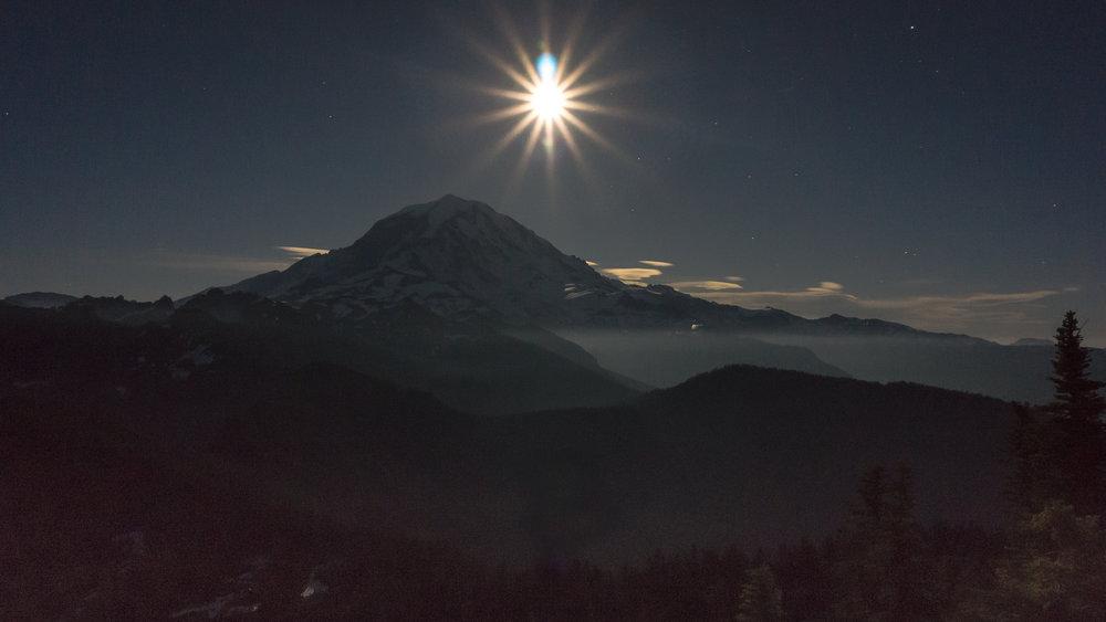 Mount Rainier beneath the full moon from Tolmie Peak Lookout.