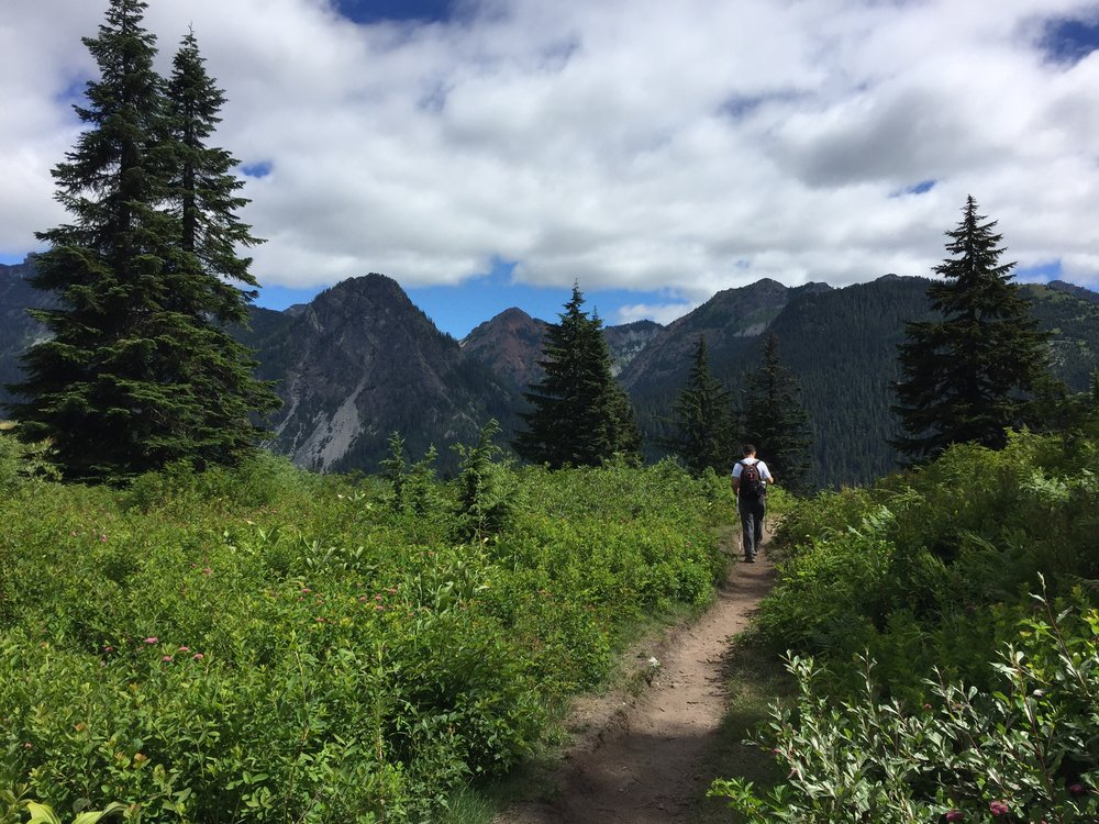 We couldn't believe the views as we emerged back at the north-facing ski slope. The clouds had lifted and the skies had cleared, so Snoqualmie Mountain, Guye Peak, Red Mountain, and Kendall Peak were all visible. [Gleeful happy dance]