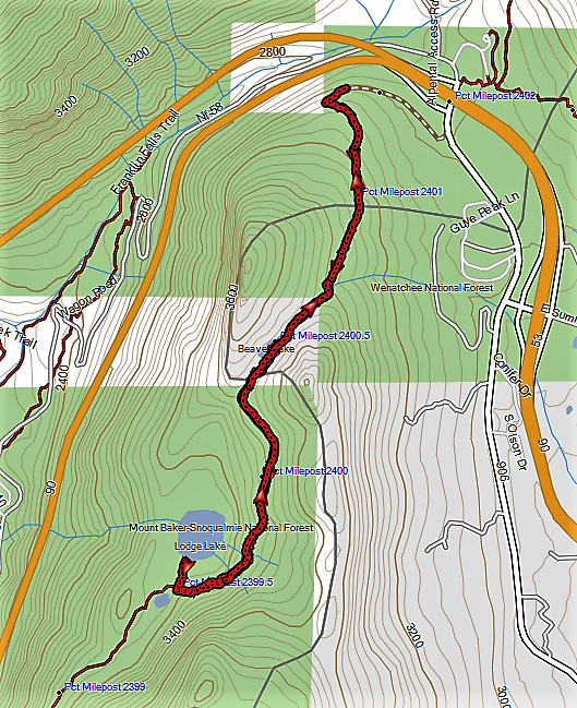 The hike follows the Pacific Crest Trail south from the Summit West parking area to a signed spur for Lodge Lake.