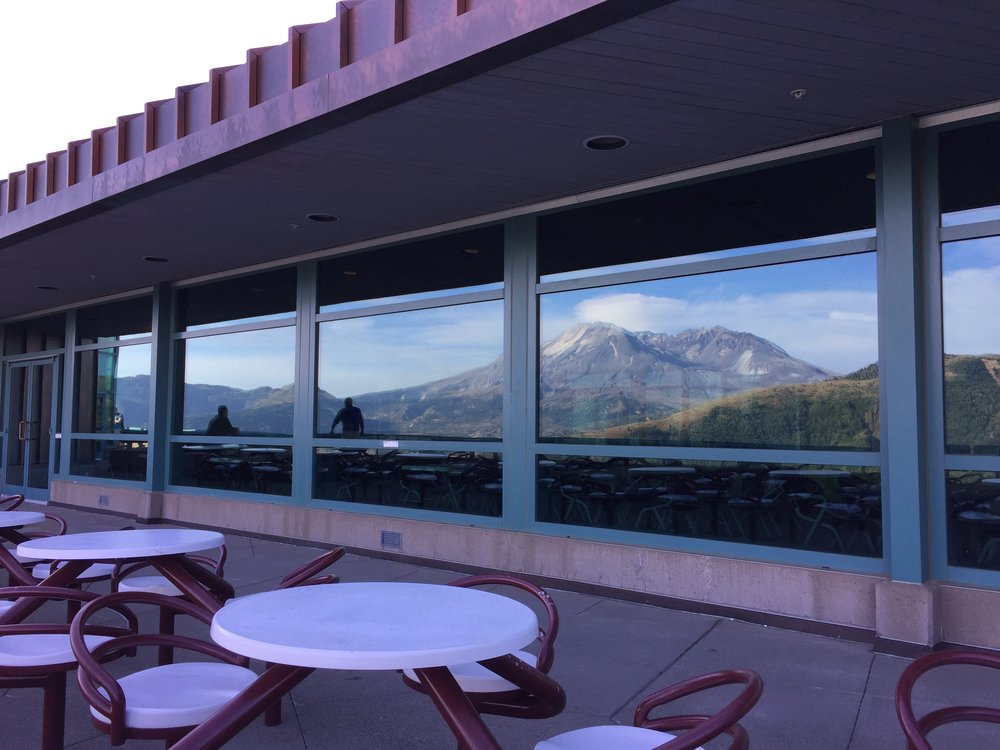 Mount St. Helens reflected in the windows at the Mount St. Helens Science and Learning Center.