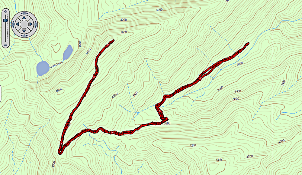 The trail to High Hut ascends southwest from the upper sno park, then switchbacks northeast for the final ascent.