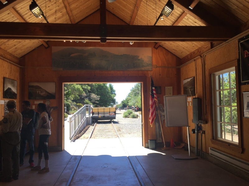 Looking out from the Gravity Car Barn to a replica of the gravity car outside.