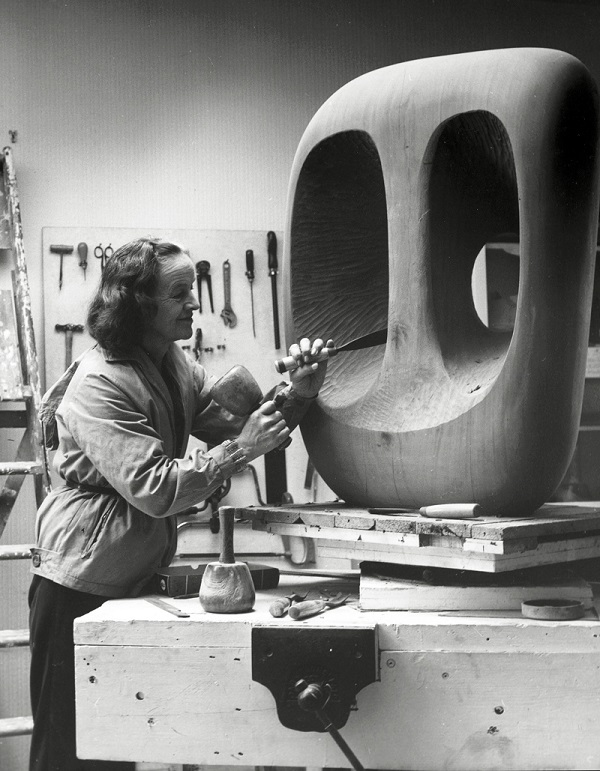 Barbara Hepworth in the Palais studio at work onthe wood carving Hollow Form with White Interior 1963Photograph: Val Wilmer, ©Bowness, Hepworth Estate